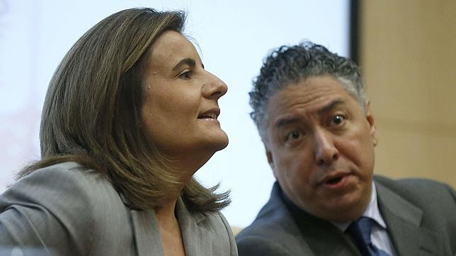 El secretario de Estado de Seguridad Social, Tomás Burgos, junto a la ministra de Empleo, Fátima Báñez
