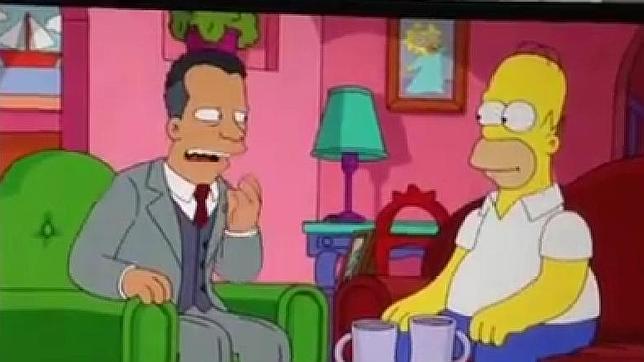 Homero Simpson, con un dirigente de la FIFA