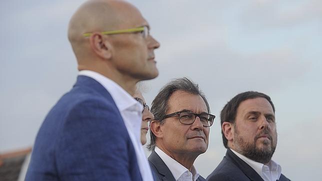 Raül Romeva, Artur Mas y Oriol Junqueras