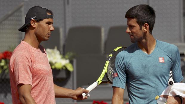 Rafa Nadal y Novak Djokovic durante uno de los entrenamientos de esta semana en la pista central Manolo Santana
