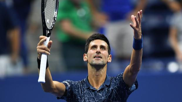 Djokovic celebra el triunfo ante Millman