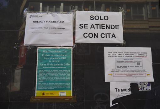 Posters on the door of a Social Security office in Madrid
