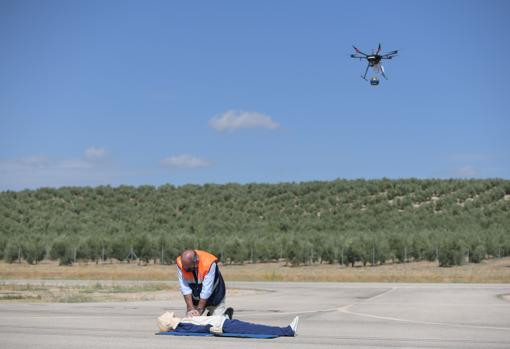 A drone transports a defibrillator in a simulated heart attack