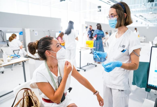 A nurse talks to a woman at the Isabel Zendal Public Emergency Hospital in Madrid