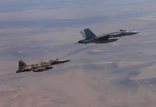 An American F-18 fighter (right), in a refueling operation with a Moroccan Air Force F-5, during an air exercise in Morocco
