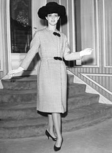 Sarah Saint Hubert, wearing a Lanvin / Castillo black and white plaid wool coat in 1962