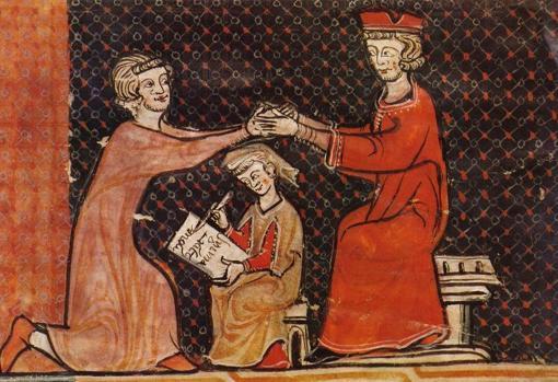 Un vasallo arrodillado realiza la inmixtio manum durante el homenaje a su señor, sentado.